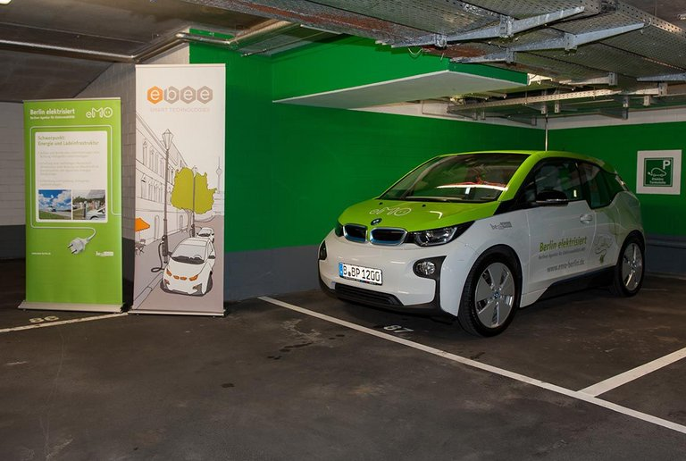 Sleep & Charge, EV charging station and electric car at centrovital Berlin